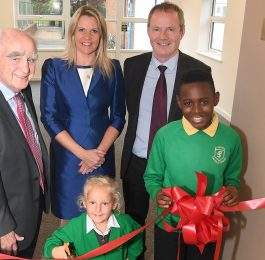 Peter Deeley joins Andrea Sherratt, Principal of St Patrick's Primary School, Patrick Taggart, Romero Catholic Academy Business Director and the school's youngest pupil Aubrie Wilson and oldest pupil Tadiwa Honye.